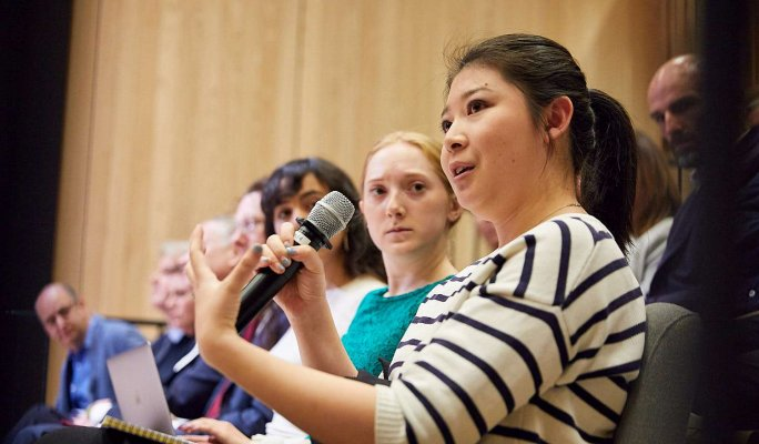 Photo of audience member commenting on discussions