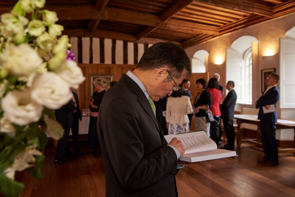 Guest studying book at book launch