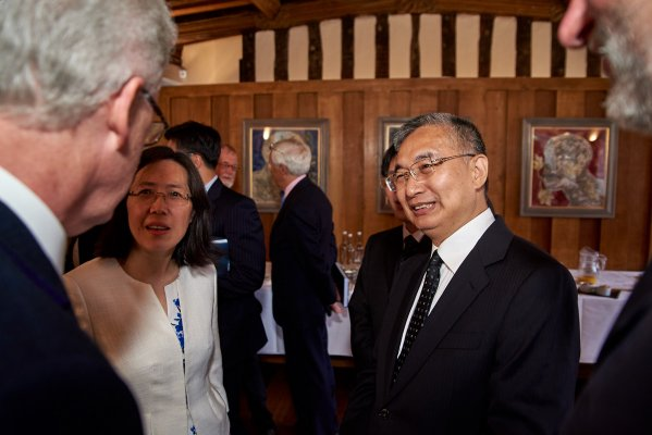 The Master, Jesus College speaking with DRC Vice President Zhang Laiming and Dr Jin Zhang