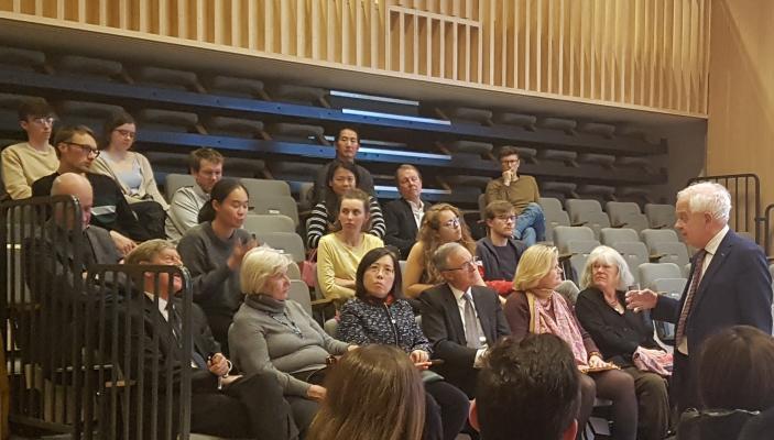Photo of John McCallum with audience