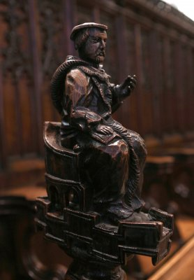Wood carved figure of a Doctor of Divinity