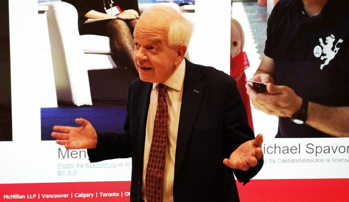 Photo of John McCallum speaking to audience