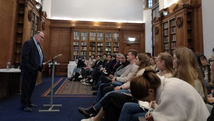 Photo of Sir Douglas Flint delivering lecture