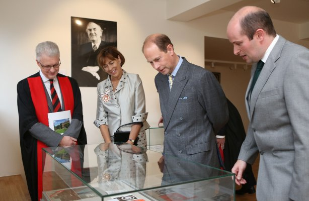 HRH The Earl of Wessex and others looking into a display case
