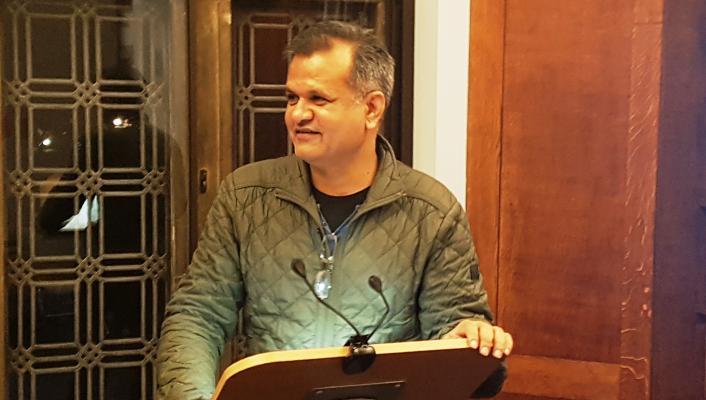 Photo of Dr Siddharth Saxena giving his presentation