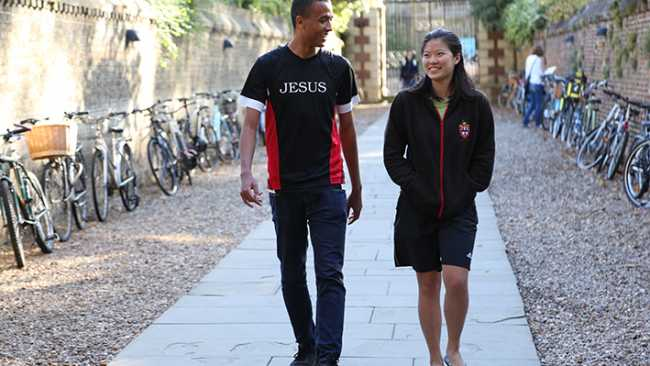 Image of Two students walk into Jesus College
