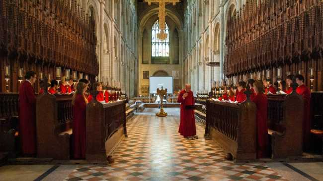 Photo of Choir singing Evensong at Peterborough Cathedral