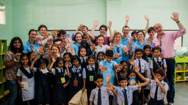 Image of Choir members with school children in India