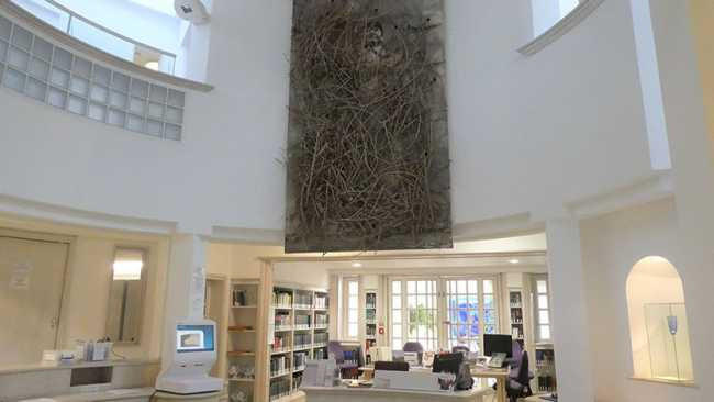 Image ofAnselm Kiefer painting of Chairman Mao displayed in College