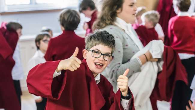 Image of A chorister giving a thumbs up