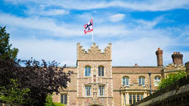 Image of Jesus College Gate Tower with flag