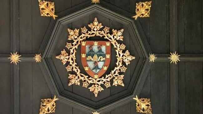 Image of Detail from the Gate tower ceiling showing College crest