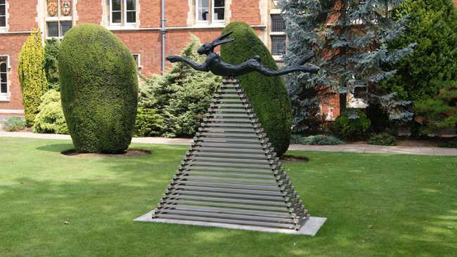 Image of Six foot leaping hare on steel pyramid by Barry Flanagan