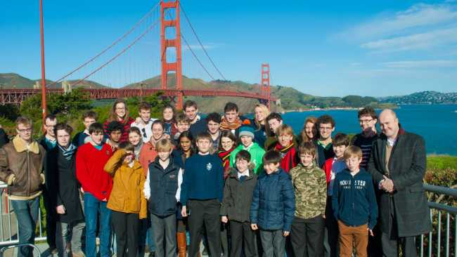 Photo of Choir standing in front of the Golden Gate Bridge